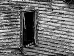 Age takes its toll (Kool Cats Photography over 11 Million Views) Tags: oklahoma outdoor old neglected window blackandwhite bw warped highcontrast windows wood house architecture sagging