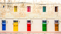 The Doors (DobingDesign) Tags: colours doors windows malta residential quayside harbourside streetphotography frontdoors marsaxlokkvillage colorful colourpop rows columns pattern rhythm lines geometric angular texture brickwork primarycolours shadow