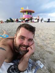 South Beach Selfie (Toni Kaarttinen) Tags: usa unitedstates florida wpb america miami miamidade southbeach artdeco architecture beach lifeguard tower lifeguardtower hut colorful man guy beard bar topless trunks oranges chest hairy hairychest smile selfie