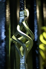 Night photo of iron curl feature (Arvind Nandan) Tags: macro bokeh closeup nightphotography lowlightphotography gate decoration decorative pattern art design steel iron feature metal