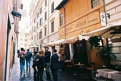 Roma (goodfella2459) Tags: nikonf4 afnikkor24mmf28dlens kodakektar100 35mm c41 film analog colour city streets roma italy rome pedestrians buildings