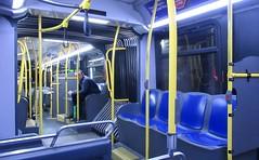 Too inquisitive... (Robert Saucier) Tags: newyork newyorkcity nyc manhattan autobus bus bleu blue jaune yellow personne people img4467