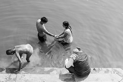 Love on the Ganges (Geraint Rowland Photography) Tags: poet poetryromance love life tender touch touching bw blackandwhite travelindia assighatinvaranasi india water lake river temple hindi hindu people documentary lifeinindia peace ripples washing bathing repairing wwwgeraintrowlandcouk geraintrowlandphotography bathingintheganges assighatinindia