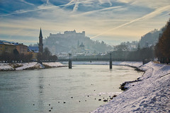 Another winter photo of Salzburg (echumachenco) Tags: salzburg city architecture history church spire steeple castle fortress festung hohensalzburg bridge müllnersteg river water salzach riverside snow winter february sky cloud landscape cityscape outdoor evangelischechristuskirche bird animal austria österreich nikond3100 haze mist