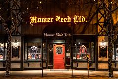 Homer Reed Ltd. (yarnim) Tags: homerreed homerreedltd storefront door colors nightstreet streetphotography street night lowlight 85mm sony sonya7iii a7m3 ilce7m3 sel85f18 christmaslights lights christmasdecoration decor