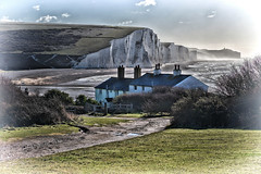 Coastguards Cottages (Croydon Clicker) Tags: cottage house building chimney window fence track path bush grass sea ocean water beach cliff hill cuckmerehaven seaford sussex eastsussex southdowns nationalpark naturereserve sky cloud white green