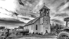Church (J K German) Tags: manchesteroklahoma oklahoma manchester blackandwhite church sky relic abandoned old farm equipment tractor cross bell catholic