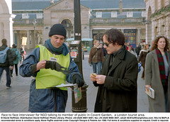 """Street Interviewer 1 (hoffman) Tags: british britishisles campaigner campaigning charity collecting collector communicating communication daylight eec england english eu europe europeanunionec facetoface finance financial fundraising greatbritain horizontal interviewer interviewing ngo outdoors recruiter recruiting recruitment street talking tourism tourist uk unitedkingdom winter davidhoffman wwwhoffmanphotoscom london davidhoffmanphotolibrary socialissues reportage stockphotos""""stock photostock photography"""" stockphotographs""""documentarywwwhoffmanphotoscom copyright"""