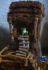 First, my coffee. Then, off for some fishin'. (Carol (vanhookc)) Tags: treehouse frogdecoration canoeboatdecoration