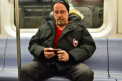 (xtaros) Tags: subway nyc newyork xtaros man cellphone mobilephone phone arcticprogram jacket subwaycarriage smartphone streetphotography street streetshots candid candidshot offthehip