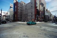 Blue (OzGFK) Tags: 35mm cinestill cinestill50d cinestillfilm japan analog film pushed3stops travel hokkaido sapporo snow winter cold cbd city empty morning nikonfm2n nikon tokina17mm f35