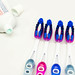 Toothbrushes and toothpaste on a white surface
