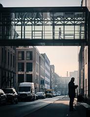 On two floors (Guido Klumpe) Tags: atmosphärisch nebel foggy fog moody mann men spiegelung reflection kontrast contrast gegenlicht shadow schatten silhouette color farbe gebäude architecture architektur building perspektive perspective candid street streetphotographer streetphotography strase hannover hanover germany deutschland city stadt streetphotographde unposed streetshot
