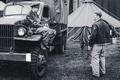 Having a natter (aquanout) Tags: blackandwhite monochrome people reenactors lorry vehicle wwii tent wheels