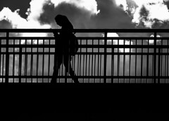 The overpass. (Lea Ruiz Donoso) Tags: structure person minimal architecture lines walking walkingaway blackandwhite monochrome blackwhite shadow light woman shadowandlight sideview onewoman puente overpass sky cloud silhouette persona lineas bw nocolor dark cloudscape