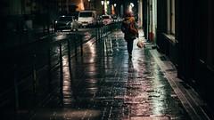 Homewards (Tom Levold (www.levold.de/photosphere)) Tags: brussels bruxelles brüssel fujixpro2 xf56mmf12 street ig night nacht regen rain spiegelung reflection copplestones pflaster frau woman
