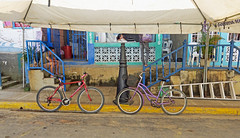 Bicycle Parking - San Juan del Sur, Nicaragua (TravelsWithDan) Tags: bicycles bikes parking canvasroof street candid man steps ladder homes people outdoors city urban sanjuandelsol nicaragua centralamerica canong3x porch gates