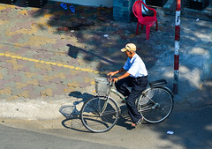 An old man biking on street in Saigon (phuong.sg@gmail.com) Tags: asia asian background basket bicycle bike burn city east hanoi hat hochiminh jacket life lifestyle looking male man moped motion moving people radiation road saigon scooter south street sun temple tourism traditional traffic transport transportation travel tropical urban vendor vietnam vietnamese white
