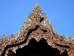 Roof detail, Shwe Yan Pyay monastery in Nyaungshwe, Myanmar (Claire Backhouse) Tags: burma burmese myanmar nyaungshwe temple monastery teak building architecture religion bluesky carving wood wooden woodworking beautiful