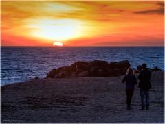 Watching the sunset at Santa Susanna (Luc V. de Zeeuw) Tags: beach man mountain people rocks sand sun sunset women santasusanna catalunya spain