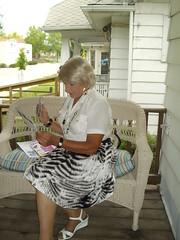 You'll Pardon Me While I Check Some Of My Fan Mail (Laurette Victoria) Tags: blonde porch skirt laurette woman