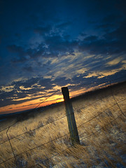 Prairie Evening (Ray Mines Photography) Tags: evening winter montana rustic rural ranch cold sunset prarie fence post orange yellow blue nature landscape scenic