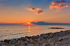 Ordinary Sunset, Santa Severa, Central Italy (Claudio_R_1973) Tags: sea seaside beach rocks nature sunset environment sun santasevera lazio centralitaly tirrenian tirreniansea mediterranean landscape atmosphere mood magenta vivid peaceful tranquil outdoor cloud