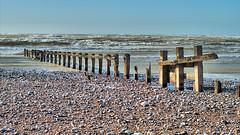 Groyne remains (Croydon Clicker) Tags: groyne fence erosion tatty worn wooden beach shingle stones sea ocean water waves sky tide cuckmerehaven sussex eastsussex