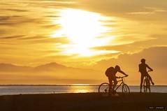 Eat My Dust (Clayton Perry Photoworks) Tags: vancouver bc canada richmond steveston spring explorebc explorecanada sunset garrypointpark clouds bicycle bike silhouettes