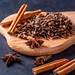 Carnation, star anise, cinnamon on a wooden Board