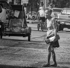 Crossing (Beegee49) Tags: street elderly woman filipino old lady crossing traffic busy blackandwhite monochrome bw panasonic fz1000 happy planet luminar skylum bacolod city philippines asia happyplanet asiafavorites