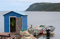 The Blue Shed Of Heart's Desire (peterkelly) Tags: digital canon 6d northamerica canada newfoundlandlabrador heartsdesire blue shed shoreline shore coast coastline picnictable harbour harbor boats boat door doorway dock rock anchor