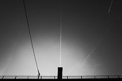 Sky lines (stefankamert) Tags: skylines sky lines light plane cable noir blackandwhite blackwhite roof chimney grain ricoh gr grii ricohgr tones