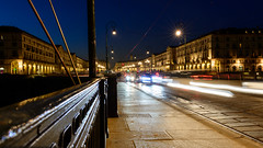 Traffic streaming from a Turin Piazza (Mister Electron) Tags: italy nikond800 piedmont torino turin piazzavittorioveneto piazza traffic cars lights evening bluehour dusk slowshutter
