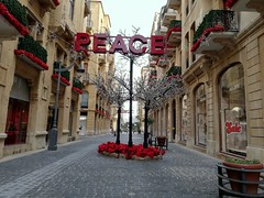Downtown, Beirut... (essam_haffar) Tags: lebanon beirut beirutsouks downtown outdoor city cities buildings architecture window red peace flowers balcony tree trip