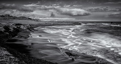 The inrushing tide (David Feuerhelm) Tags: mono monochrome bw blackandwhite contrast nikkor noiretblanc schwarzundweiss blancoynegro wideangle landscape seascape cliffs sea tide waves clouds nature water iceland coast beach nikon d750 1635mmf4 longexposure ndfilter