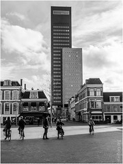 Tower blocks intruding on a townscape (FlickrDelusions) Tags: thenetherlands friesland leeuwarden street people nederland bw blackandwhite architecture nl netherlands