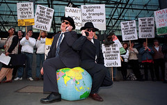 """Anti Globalisati (hoffman) Tags: 3rd business businessman businessmen coates demonstration economics economy foe globalisation globalization globe horizontal juniper mai outdoors placards poverty protest street talking telephone third trade wdm world 181112patchingsetforimagerights davidhoffman wwwhoffmanphotoscom uk davidhoffmanphotolibrary socialissues reportage stockphotos""""stock photostock photography"""" stockphotographs""""documentarywwwhoffmanphotoscom copyright"""