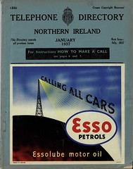 Post Office Telephone - telephone directory Northern Ireland, January 1937 edition, with Esso advert. (mikeyashworth) Tags: mikeashworthcollection gpo postofficetelephones telephonedirectory bookcover advertising esso essolube callingallcars radiotransmitter graphicdesign typography typeface northernireland ulster belfast 1937
