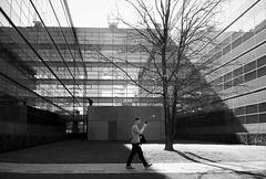 Lines and light (peer.heesterbeek) Tags: light lines monochrome man walking eindhoven netherlands building tue