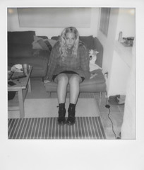 Day 099 (H o l l y.) Tags: polaroid 600 instant film analog bw black white no color self portrait girl alone couch dog retro indie vintage fashion flannel swimming relaxing before going indiana hell