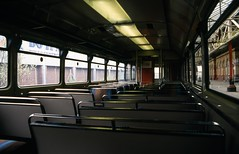 Class 142 DMU interior, 18/04/1992 [slide 9216] (graeme9022) Tags: leyland bus body railbus british rail railways br orange turquoise beige brown seats bench local regional passenger transport transportation north northern england do it all uk train station lights floursecent west railcar diesel multiple unit