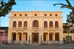 LICEO (Juan Paz V) Tags: building architecture trees blue sky facade construction morning street placetas cuba villa clara