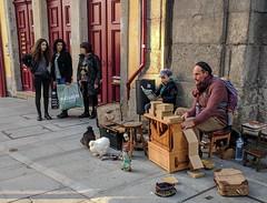 organ player with chickens & toddler (xd_travel) Tags: porto portugal oporto travel newyear2019 streetmusician chicken gnome menatwork barrelorgan streetorgan organgrinder toddlerontheback ribeira