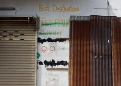 No More Free Pick Ups (mikecogh) Tags: luangprabang sign business closed corrugatediron rusty eyes graffiti rolladoor