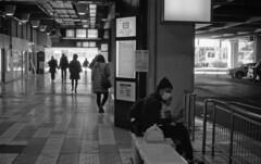 At a bus terminal (odeleapple) Tags: leica m3 carl zeiss planar 50mm kodaktmax100 film monochrome analog bw bus terminal passenger