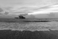 West Pier (Crisp-13) Tags: black white monochrome west pier brighton east sussex pebble beach sea coast waves
