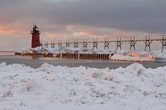 South Haven lighthouse (ericstadler83) Tags: warm earth world your explore favorite fave gorgeous beautiful pier sunset evening coast lake water haven south michigan pure ice snow lighthouse winter light hour golden landscape sel70200g telephoto 70200mm a6000 sony