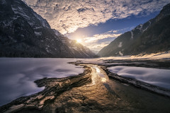 Ice Lake (Manuel.Martin_72) Tags: glarus swissalps switzerland drama enchanting lightdrama magic majestic gorge ice icecave lake mountainpeaks mountainslope mountains rocks stones trees valley woods frozen reflections snow water waterreflections clouds cloudy glow sun evening sunset klöntalersee ch