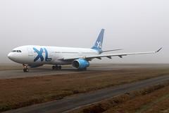 Airbus A330-303 XL Airways France F-HXLF (Niko Hpx) Tags: airbus a330303 airbusa330303 a333 330303 xlairwaysfrance xl xlairways fhxlf fwwka msn1360 cn1360 y408 gecf680e1a3 generalelectric cf6 fog badweather taxiway se xlf sharklet sharklets nte lfrs nantesatlantique nantes rolling